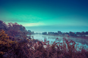 Early morning, dawn over the lake. Misty morning, rural landscape