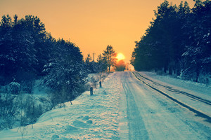 Early morning, road covered with snow at sunrise