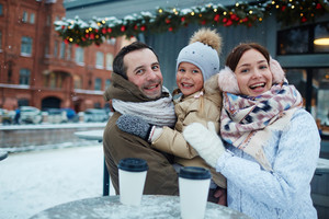 Ecstatic family hanging out in the city on wintery day
