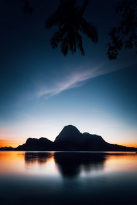 El Nido silhouette of beautiful Cadlao Island in dusk light after sunset in Palawan Island, Philippines