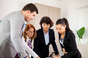 Elegant business partners planning work at meeting. Team meeting.