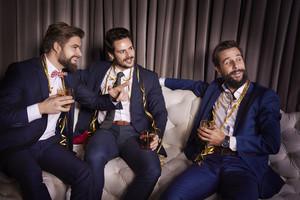 Elegant men with whiskey admiring women