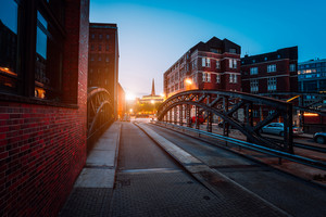 Empty Poggenmuehlen Bridge at twilight. Hamburg, Germany. illuminated buildings and last sunrays. Warehouse District -Speicherstadt Landmark of HafenCity quarter. Most visited touristic famous place