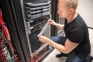 Engineer Checking Computer Server In Datacenter