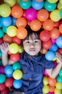 face of asian children in colorful ball pool