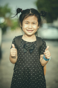 face of asian children smiling face and sign good feeling by finger