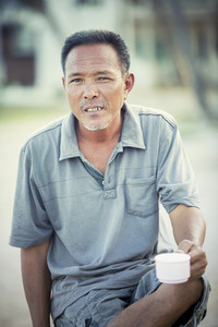 face of asian man relaxing emotion looking with eyes contact to camera