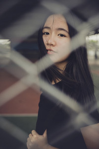 face of cheerful asian teenager standing outdoor