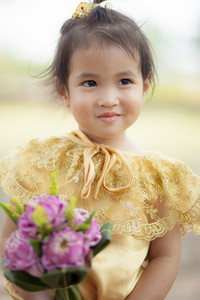face of lovely asian children wearing old thai tradition clothes  smiling face standing outdoor