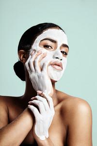 facial treatment concept. woman's portrait with a facial mask
