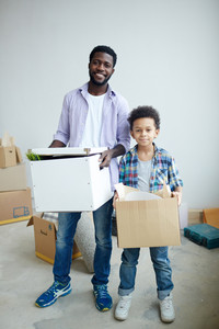 Family of father and son holding boxes