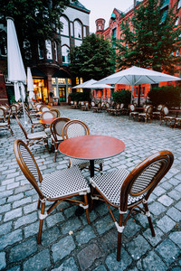 Famous Water Castle Restaurant in Speicherstadt, Outside. Tables and chairs at cobbled square. Hamburg, Germany