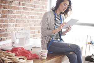 Female owner using digital tablet