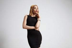femenine delicate woman in black dress