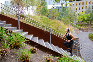 Fit sports women running interval workout in stairs in city park