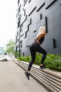 Fit Woman Doing Step Workout Outdoor in the City
