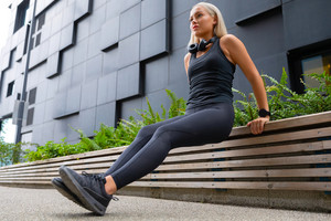 Fit Woman Doing Triceps Dips Outdoor in Modern City