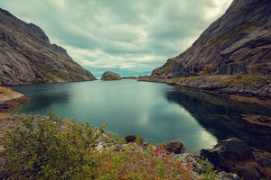 Fjord in evening in rainy day, Rocky beach. Beautiful nature of Norway. Lofoten islands