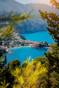 Framed by nature view to Assos village Kefalonia. . Beautiful blue colored bay lagoon water surrounded by pine and cypress trees. Greece
