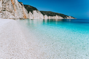 Fteri beach in Kefalonia Island, Greece. Most beautiful beach with pure azure emerald sea water surrounded by high white rocky cliffs