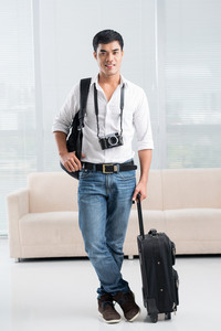 Full-length portrait of a young traveler with the equipment
