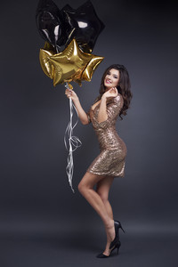 Full length portrait of attractive woman with balloon