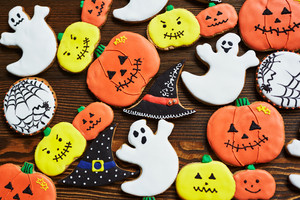 Funny Hallween cookies on wooden background