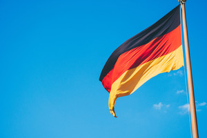 German national flag on blue sky background
