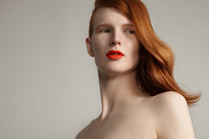 ginger hair model portrait with ideal beauty skin. closeup portrait