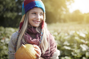 Girl holding a halloween pumpkin