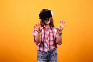 Girl in jeans dancing while she has her VR on. Dancing time.