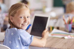 Girl using digital tablet at school
