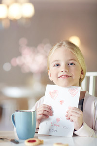 Girl with handmade greeting card