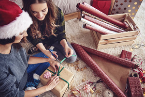 Girls  preparing a present for christmas
