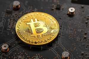 Gold bitcoin on crypto mining GPU circuit board computer hardware