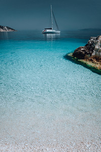 Gorgeous seascape with white yacht on calm water. Summer vacation holiday luxury travel romantic honeymooning concept