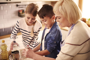 Grandmother and kids preparing something special
