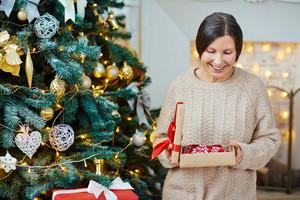 Grandparent opening gift-box with winterwear
