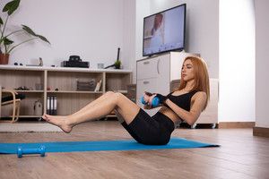 Great abs lateral rises during home workout. Girl getting in shape.