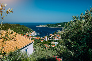 Greece, the island of Ithaca Ithaki. Stunning view of the remote Mediterranean town, olive groves and blue sea bay. Vacation in Greece, summer time