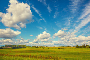 Green field and beautiful blue sky with clouds