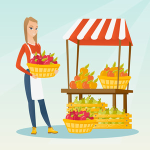 Greengrocer standing near the stall with fruits and vegetables. Greengrocer standing near the market stall. Greengrocer holding basket with fruits. Vector flat design illustration. Square layout.