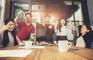 group of asian younger freelancing team work happiness emotion in home office