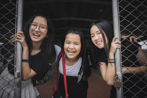 group of cheerful asian teenager happiness emotion in school sport gymnaseum