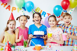 Group of happy children celebrating birthday