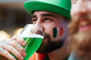 Guy in green hat drinking beer