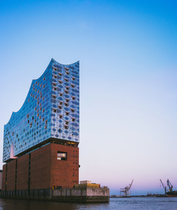 Hamburg, Germany - April 8, 2018: Top shape of Elbphilharmonie on bright blue sky with some lilac sunset colors, Hamburg, Germany
