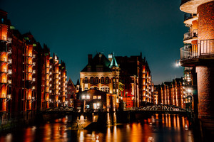 Hamburg, Germany. View of Wandrahmsfleet at dusk in light illumination. Located in Warehouse District -Speicherstadt Landmark of HafenCity quarter. Most visited touristic famous place
