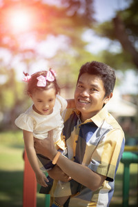 happiness emotion of asian father and daughter in green  garden