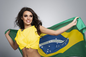 Happy beautiful brazilian female soccer fan